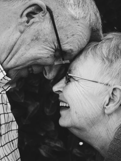 Picture of a senior couple smiling at one another