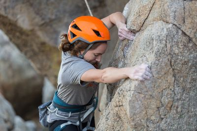 Picture of female adult climbing a rock